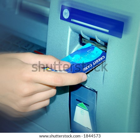 ATM. Inserting A Card. - stock photo