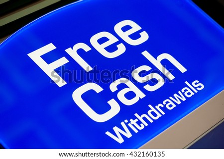 ATM Machine - Free Cash Withdrawals Sign - stock photo