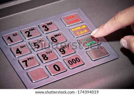 ATM machine keypad numbers. Entering atm cash machine pin code - stock photo