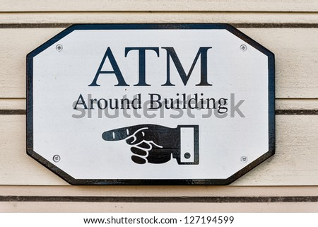 ATM sign on wooden wall - stock photo