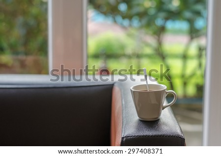 atmosphere around office blur background with bokeh and cup of coffee in the morning