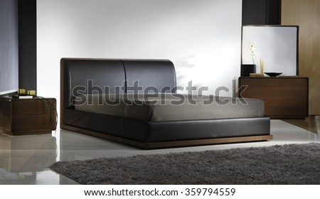 ATMOSPHERIC BEDROOM INTERIOR . BLACK LEATHER BED . - stock photo