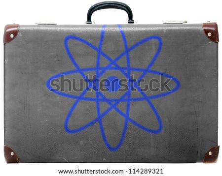 Atom symbol painted on old grungy travel suitcase or trunk - stock photo