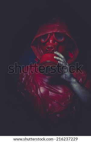 atomic nuclear concept, man with red gas mask - stock photo