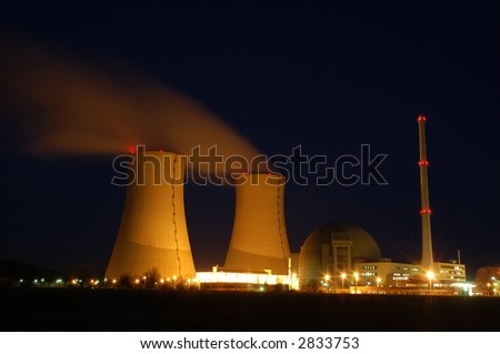 atomic power plant by night - stock photo