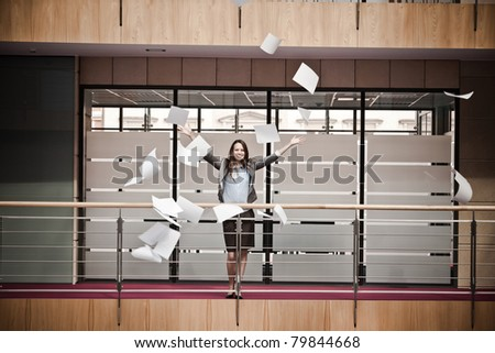 Atractive business woman throwing documents