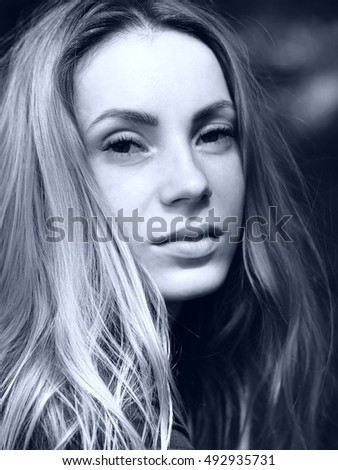 Atractive cute young caucasian girl in black and white, face. long haired