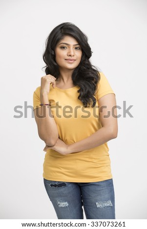 Atractive indian model posing isolated on white - stock photo