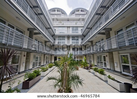 atrium of a modern multi-storey residential development - stock photo