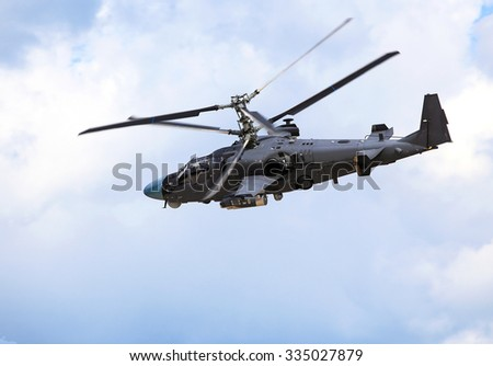 Attack helicopter armed with rockets, bombs, guns and able to fight day and night - stock photo
