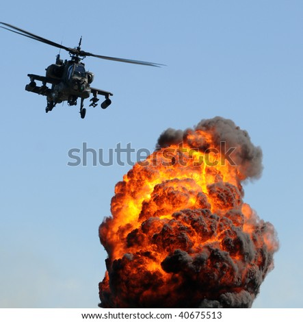 Attack helicopter delivering fire and smoke - stock photo