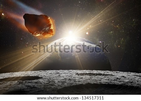 Attack of the asteroid on the moon in the universe. Abstract illustration of a meteor impact. Picture of Earth belongs to NASA.