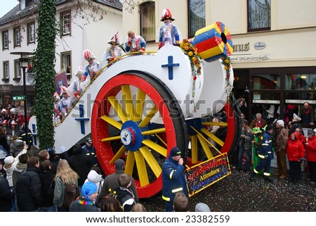 ATTENDORN, GERMANY - FEBRUARY 5, 2008: Carnival procession on Shrove Tuesday, traditional yearly masquerade in a little German town, February 5, 2008 in Attendorn near Cologne. - stock photo