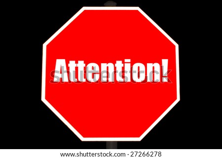 Attention concept on a bright red stop sign isolated on black - stock photo