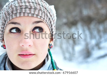 Attention - looking sideways. Portrait of a beautiful young woman,looking sideways - stock photo