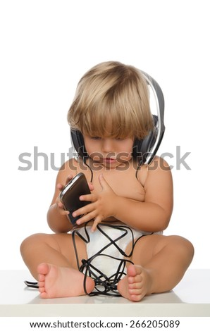 Attentive child with headphones and smartphone isolated on white - stock photo