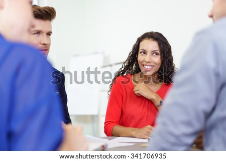 Attentive Colleagues Listening to their Team Leader During a Meeting Inside the Office. - stock photo