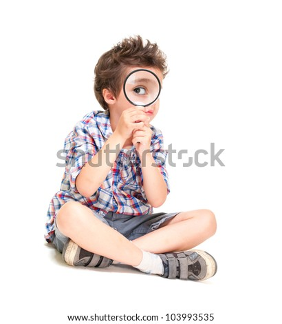 Attentive little boy with weird hair researching using magnifier isolated on white - stock photo