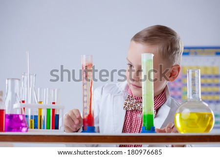 Attentive scientist watching chemical reaction