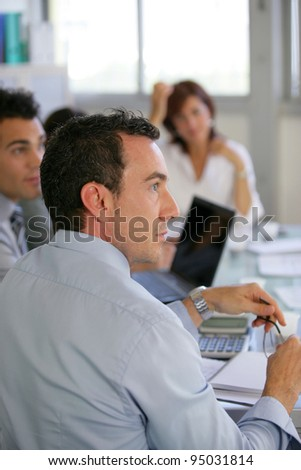 Attentive workers in business meeting - stock photo