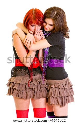 Attentive young girl hugging and calming her sad girlfriend isolated on white - stock photo