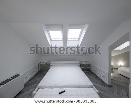 Attic bedroom - stock photo
