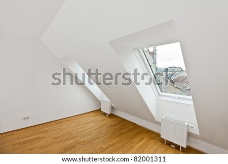 attic flat with wooden floor - stock photo