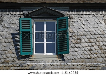 Attic window A tiled roof with a closed attic window - stock photo