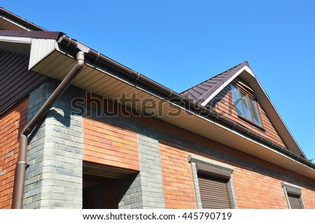 Attic with new installed rain gutter and downspout pipe.