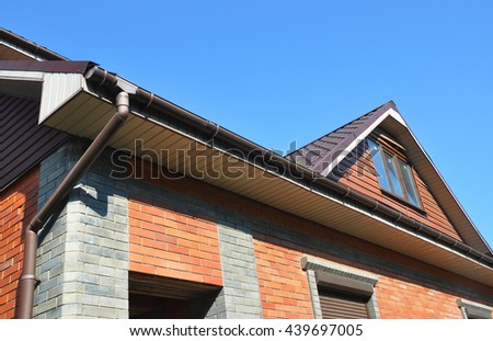 Attic with rain gutter pipe.