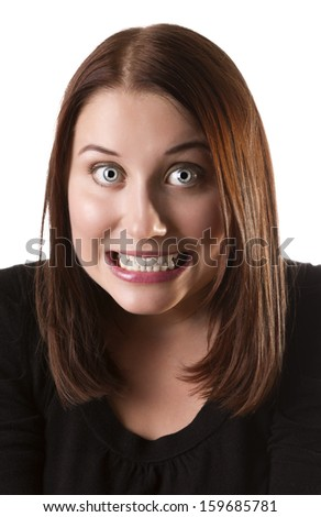Attracive young woman makes a grimace, isolated on white background - stock photo