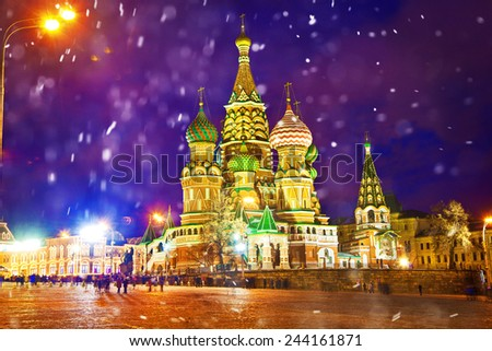 Attractions Moscow - St. Basil's Cathedral on Red Square. Winter city landscape, snow falls - stock photo