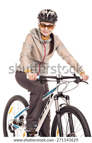 Attractive adult woman cyclist isolated on white background, studio shot.