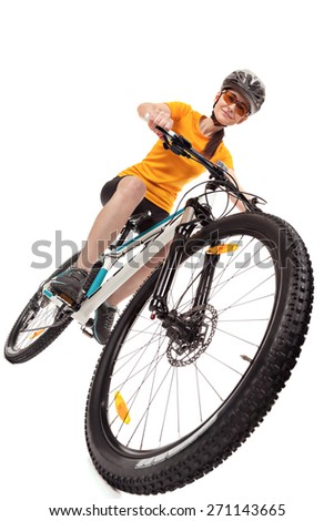 Attractive adult woman cyclist isolated on white background.  Studio shot,  low angle. - stock photo