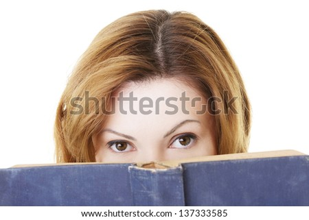Attractive adult woman with books, isolated on white - stock photo
