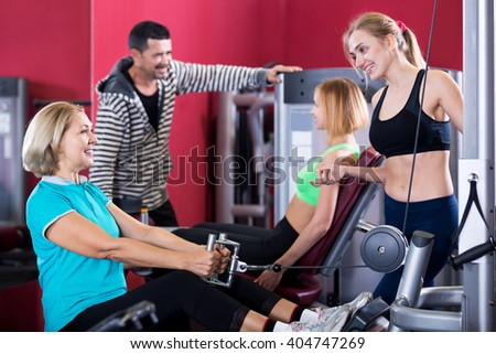 Attractive adults of different age having strength training in gym