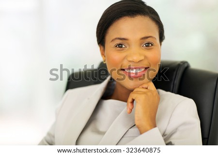 attractive african american business executive looking at the camera - stock photo