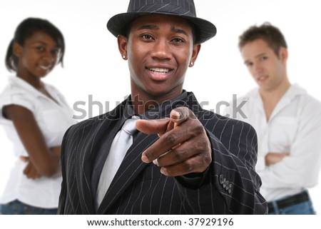 Attractive African American business man in pinstripe suit pointing towards camera. - stock photo