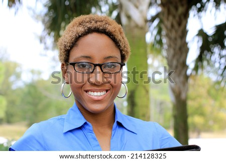 Attractive African American Business Professional Business Woman Smiling and Happy Looking  - stock photo