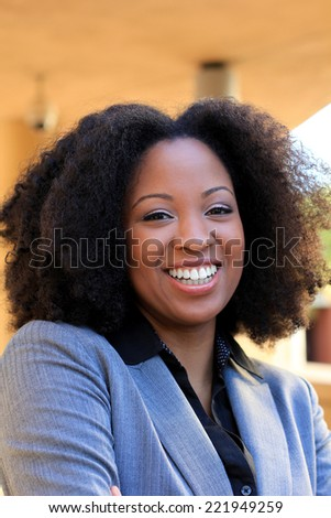 Attractive African American Business Professional Business Woman Smiling and Happy Wearing a Suit - stock photo