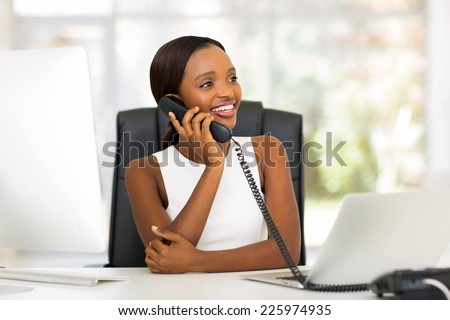 attractive african american businesswoman using landline phone - stock photo