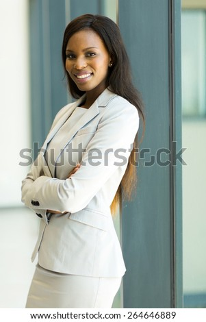 attractive african american corporate worker standing in office - stock photo