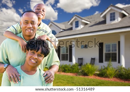 Attractive African American Family in Front of Beautiful House. - stock photo