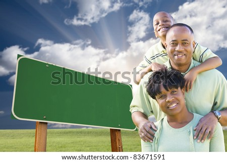 Attractive African American Family in Front of Blank Green Road Sign Ready for Your Own Message. - stock photo