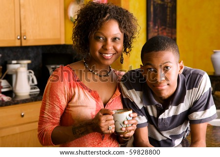 Attractive African-American family members posed in kitchen