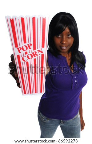 attractive african-american woman holding a container of popcorn on a white background - stock photo