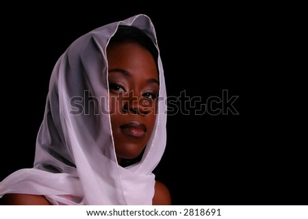 Attractive African American woman in white head scarf - stock photo