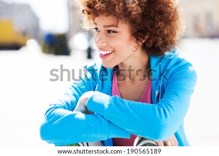 Attractive African American woman outdoors - stock photo