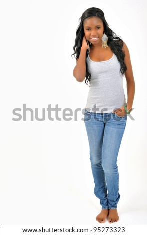 Attractive African-American young woman in grey tank top and denim - model in studio - smiling