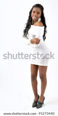 Attractive African-American young woman in white dress - model in studio - smiling
